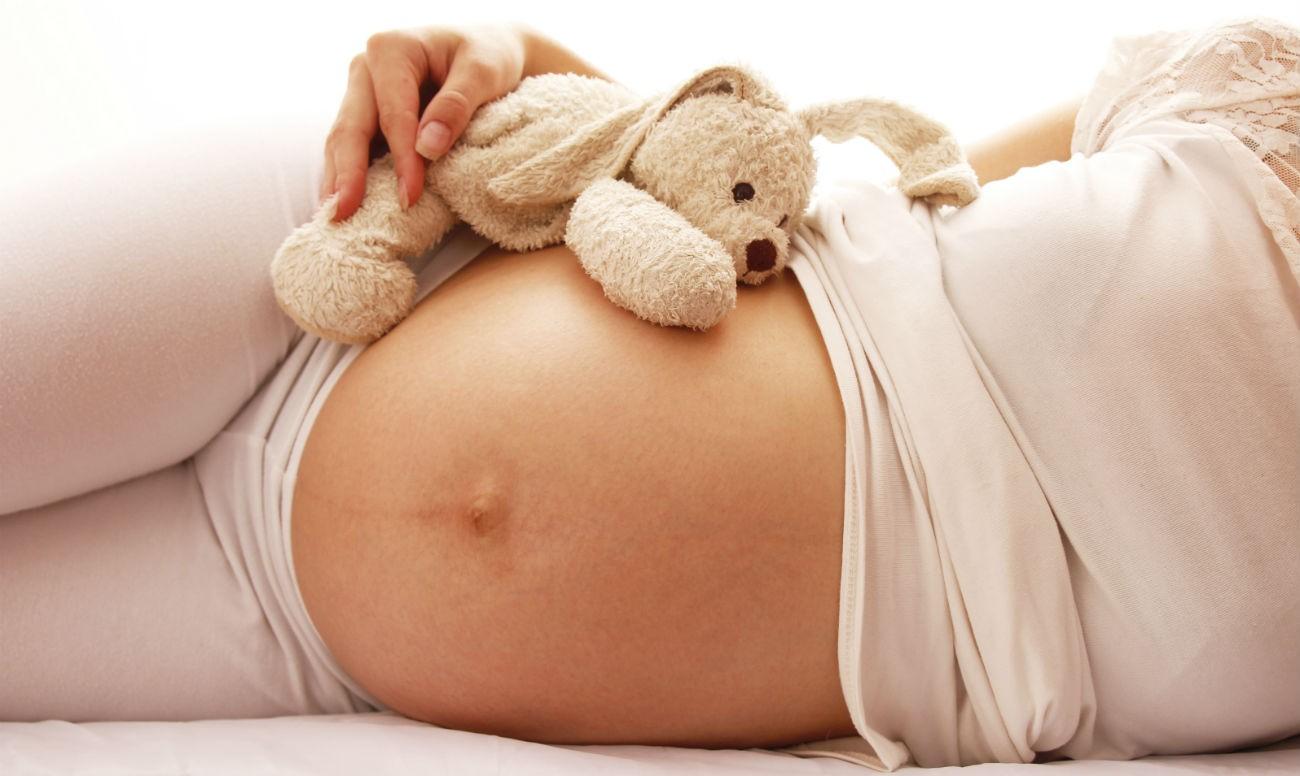 Беременная девушка - фото